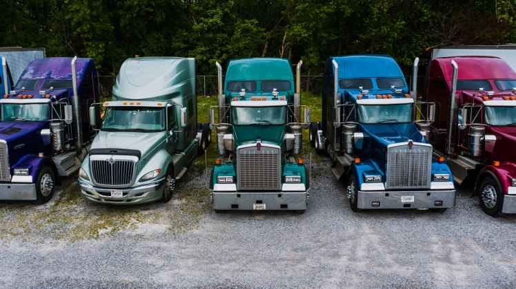 industrial retro style trucks parked in row